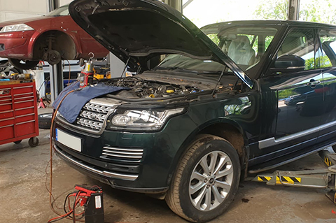 CCM Mechanic Inspects Land Rover Under Bonnet