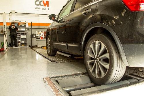 Black car being MOT tested at CCM Garages