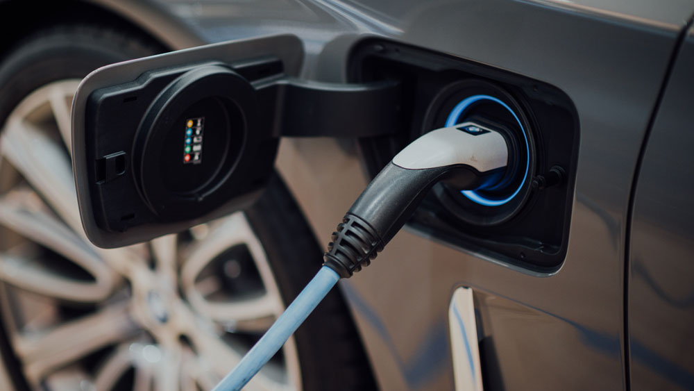 Electric Car on Plugged into a Charger