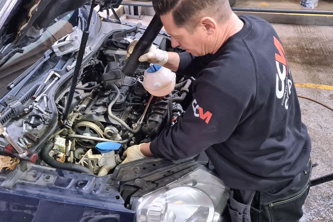 CCM Mechanic Changes a Timing Belt